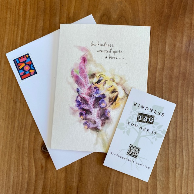 A Kindness Buzz card with envelope