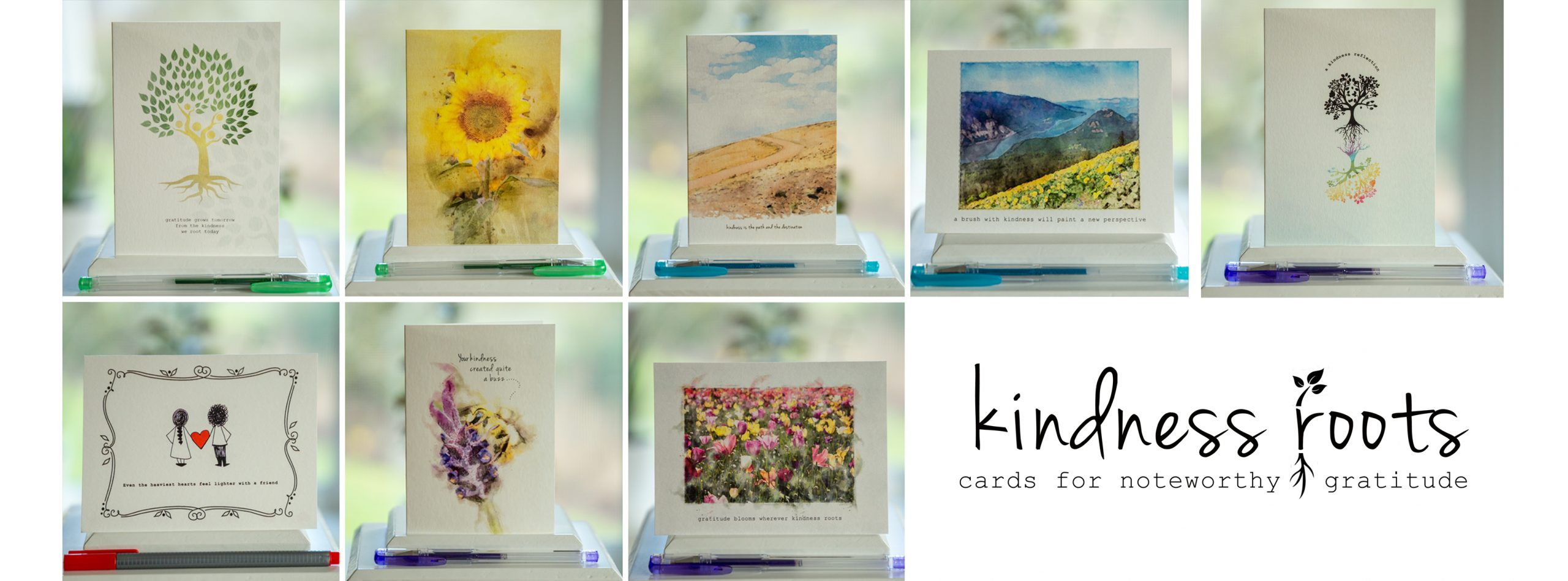Selection of cards from Kindness Roots with a sunflower card on top.