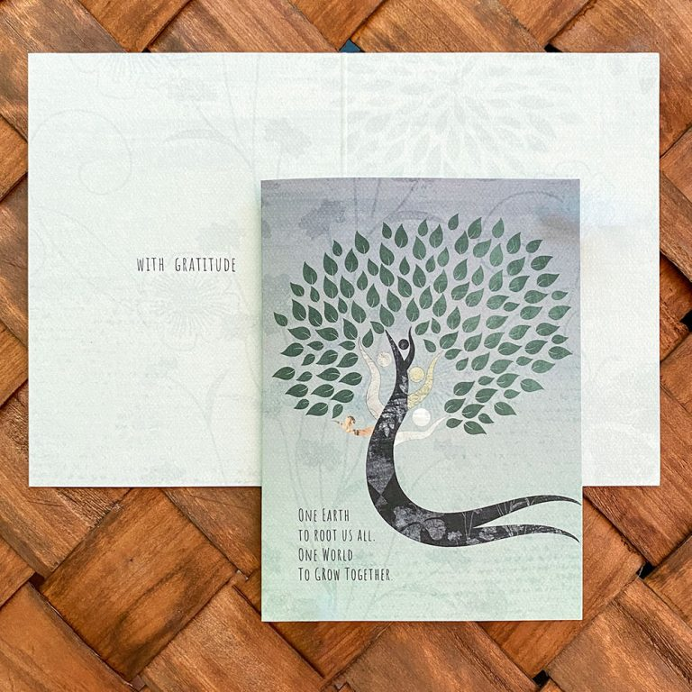 The cover and inside of a gratitude card with a tree that appears to be dancing with multi-colored branches and text: One Earth to root us all. One world to grow together.