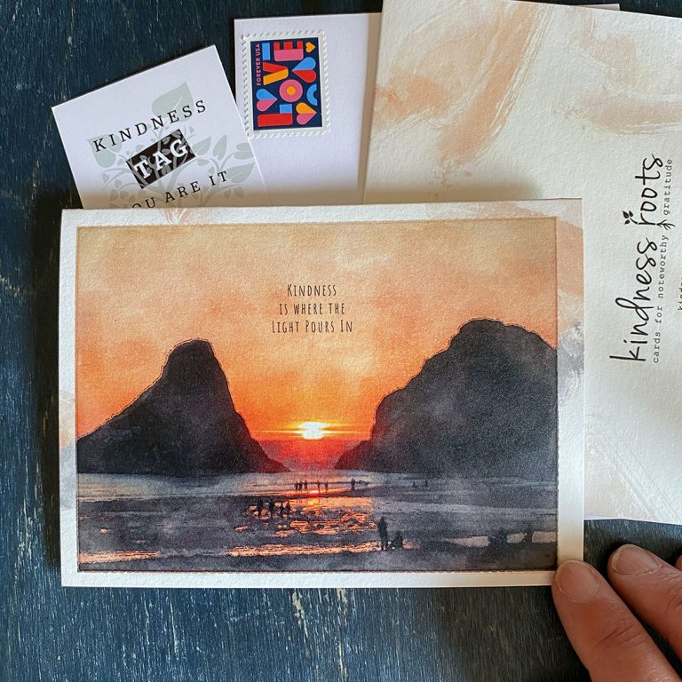 A gratitude card with a watercolor image of an orange sunset over the Oregon Coast between haystack rocks.